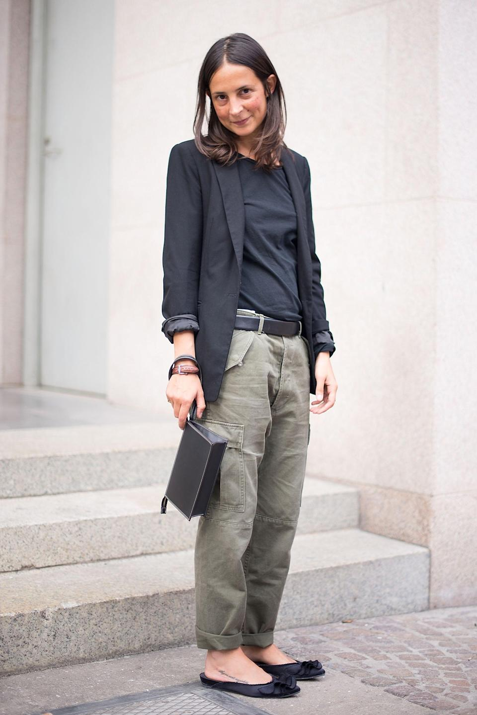 <p>This take-your-cargo-pants-to-work look relies on understated separates, simple, functional footwear, and a blazer to tie it all together.</p>