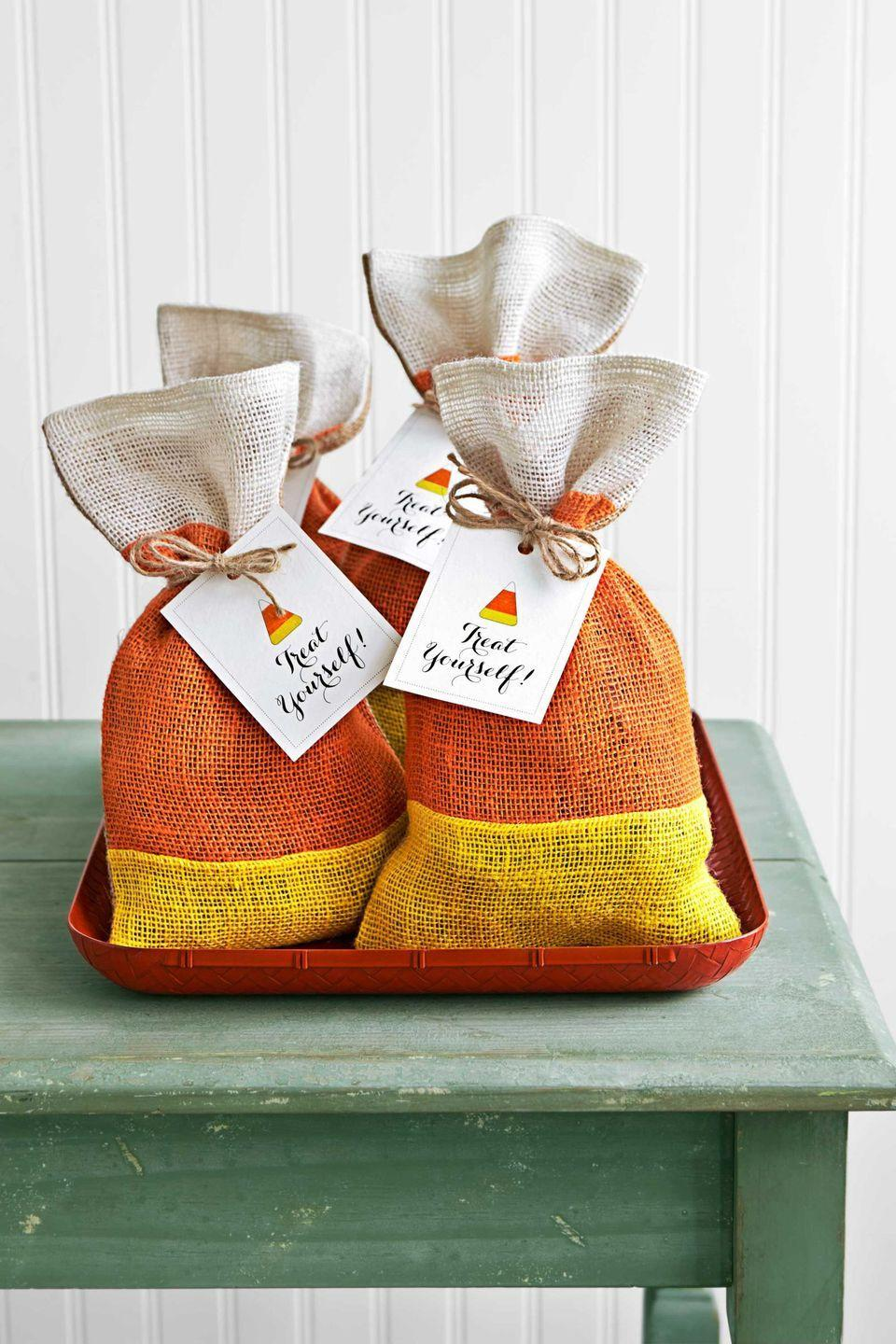 """<p>A sweet treat that also adds a festive element to the house? Yes please. </p><p><em>Get the tutorial at <a href=""""https://www.countryliving.com/diy-crafts/g1189/best-halloween-crafts-ever/?slide=34"""" rel=""""nofollow noopener"""" target=""""_blank"""" data-ylk=""""slk:Country Living"""" class=""""link rapid-noclick-resp"""">Country Living</a>.</em> </p><p><strong>What You'll Need: </strong><a href=""""https://www.amazon.com/Amariver-Natural-Drawstring-Reusable-Birthday/dp/B071HYKQHW?linkCode=ogi&tag=syn-yahoo-20&ascsubtag=%5Bartid%7C10070.g.1279%5Bsrc%7Cyahoo-us"""" rel=""""nofollow noopener"""" target=""""_blank"""" data-ylk=""""slk:Burlap bags"""" class=""""link rapid-noclick-resp"""">Burlap bags</a> ($9, Amazon)</p>"""
