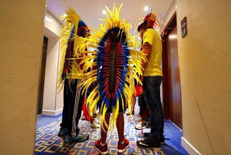 Columbian soccer team supporter Miguel Clavijo wears a Penacho as he waits in the hotel corridor with fellow supporters as they prepare for their team's World Cup Soccer match against Senegal at Samara Stadium in Russia, June 28, 2018. REUTERS/David Gray