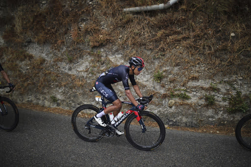 Colombia's Egan Bernal rides with the pack during the first stage of the Tour de France cycling race over 156 kilometers (97 miles) with start and finish in Nice, southern France, Saturday, Aug. 29, 2020. (AP Photo/Daniel Cole)