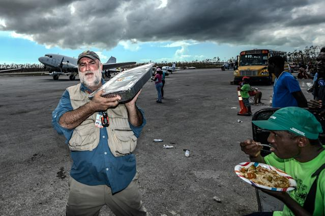 """<div class=""""caption""""> Chef Jose Andres delivers food from World Central Kitchen at Treasure Cay International Airport. </div> <cite class=""""credit"""">Dom Furore</cite>"""