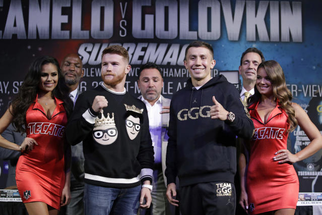 Canelo Alvarez, left, and Gennady Golovkin pose at Wednesday's news conference. (AP)