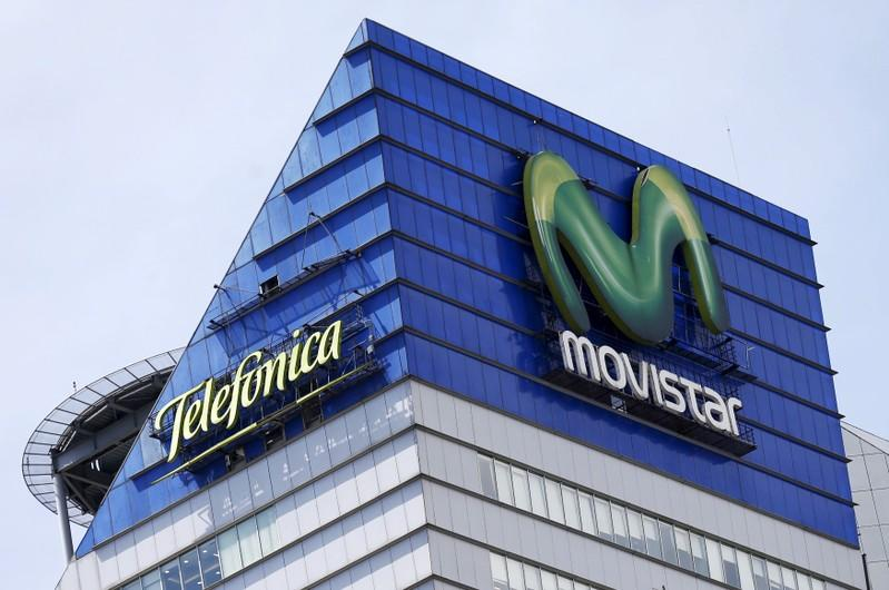 FILE PHOTO: Logos for Telefonica and its Movistar telecoms brands are seen on top of a Telefonica Mexico building, Mexico City, Mexico, April 15, 2016.