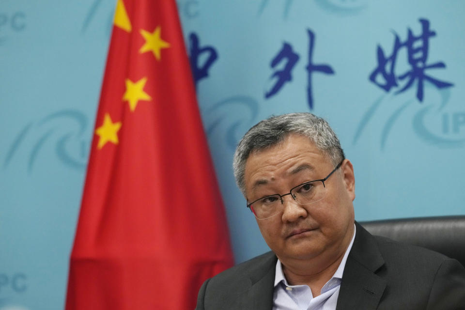 """FILE - In this Aug. 25, 2021, file photo Fu Cong, a Foreign Ministry director general, speaks at a briefing for foreign journalists at the Foreign Ministry in Beijing, China. U.S. intelligence agencies remain divided on the origins of the coronavirus but believe China's leaders did not know about the virus before the start of the global pandemic, according to results released Friday, Aug. 27, of a review ordered by President Joe Biden. China's foreign ministry attacked the U.S. investigation ahead of the report's release. Fu Cong, a Foreign Ministry director general, said at a briefing for foreign journalists that """"scapegoating China cannot whitewash the U.S."""" (AP Photo/Ng Han Guan, File)"""