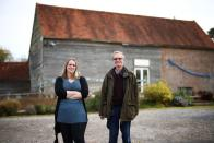 Antony Penrose and Ami Bouhassane, son and granddaughter of American photographer and surrealist Lee Miller, pose at Farleys House & Gallery, which they run together, in Muddles Green