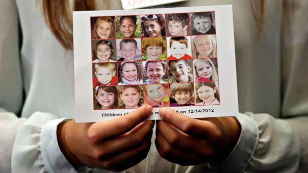 PHOTO: Kyra Murray holds a photo showing victims of the shooting at Sandy Hook Elementary School during a press conference at the U.S. Capitol calling for gun reform legislation, Sept. 18, 2013, in Washington, D.C. (Win McNamee/Getty Images, FILE)