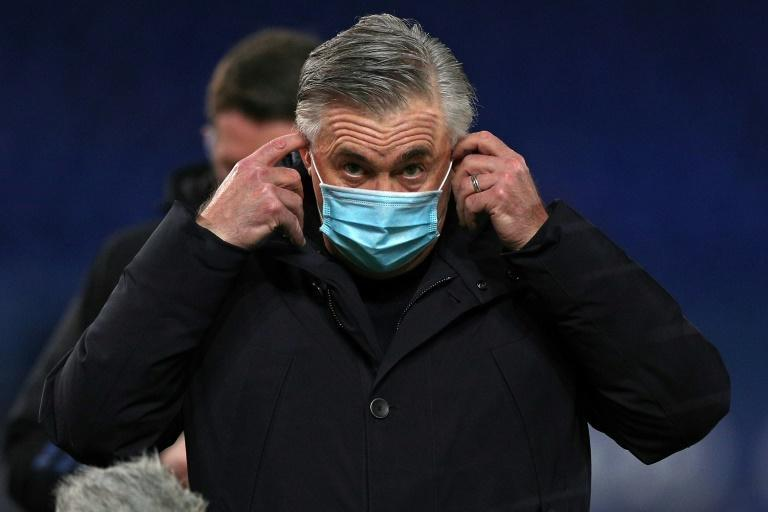 Everton coach Carlo Ancelotti adjusts his face mask after his side lost to West Ham on January 1