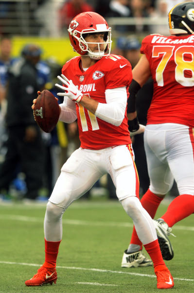File-This jan. 28, 2018, file photo shows AFC quarterback Alex Smith (11), of the Kansas City Chiefs, looking to pass, during the first half of the NFL Pro Bowl football game against the NFC, in Orlando, Fla. The Alex Smith era has begun in Washington as the Redskins completed their trade for the veteran quarterback. Smith joined the Redskins from the Kansas City Chiefs in exchange for a third-round pick and cornerback Kendall Fuller. The deal and Smiths subsequent four-year contract extension were agreed to in February but couldnt become official until 4 p.m. EDT Wednesday, March 14, 2018, the start of the new league year. (AP Photo/Steve Nesius, File)