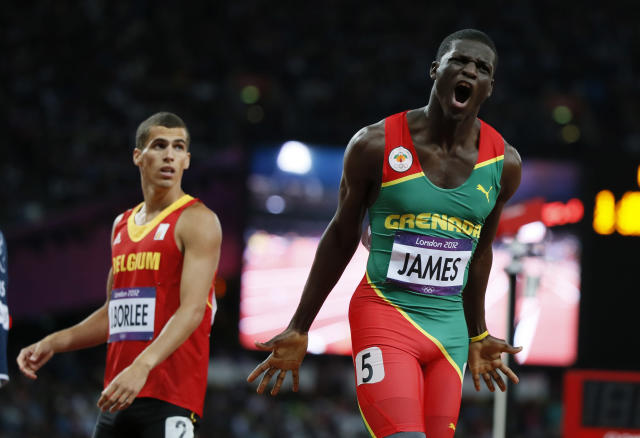 Grenada's Kirani James (R) reacts next to Belgium's Jonathan Borlee after winning the men's 400m final at the London 2012 Olympic Games at the Olympic Stadium August 6, 2012. REUTERS/Lucy Nicholson (BRITAIN - Tags: OLYMPICS SPORT ATHLETICS)