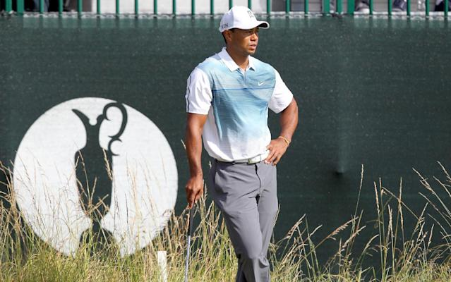 Tiger Woods looks on from the edge of the 3rd green during the opening day of the British Open Golf Championship at Royal Liverpool in Hoylake on July 17, 2014 (AFP Photo/Peter Muhly)