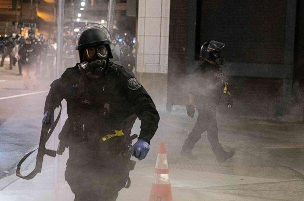 PHOTO: A Detroit Police officer uses tear-gas during a protest in the city of Detroit, Michigan, on May 29, 2020, over the death of George Floyd, a black man who died after a white policeman kneeled on his neck for several minutes.  (Seth Herald/AFP via Getty Images)