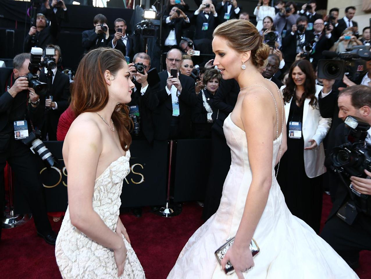 Actresses Kristen Stewart, left, and Jennifer Lawrence arrive at the Oscars at the Dolby Theatre on Sunday Feb. 24, 2013, in Los Angeles. (Photo by Matt Sayles/Invision/AP)