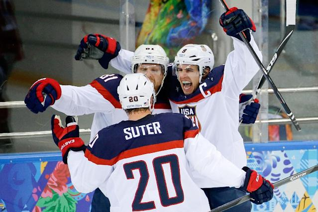 USA forward Zach Parise (9) celebrates his goal against the Czech Republic with teammates Phil Kessel (81) and USA defenseman Ryan Suter during the second period of men's quarterfinal hockey game in Shayba Arena at the 2014 Winter Olympics, Wednesday, Feb. 19, 2014, in Sochi, Russia. (AP Photo/Matt Slocum)
