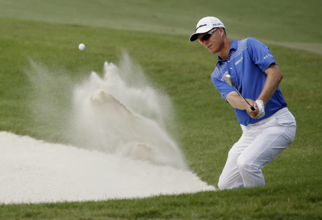 John Senden, of Australia, hits from a bunker on the 11th hole during the third round of The Players championship golf tournament at TPC Sawgrass, Saturday, May 10, 2014, in Ponte Vedra Beach, Fla. (AP Photo/John Raoux)