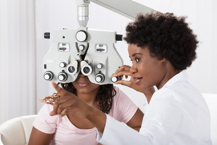 A doctor giving a patient an eye exam
