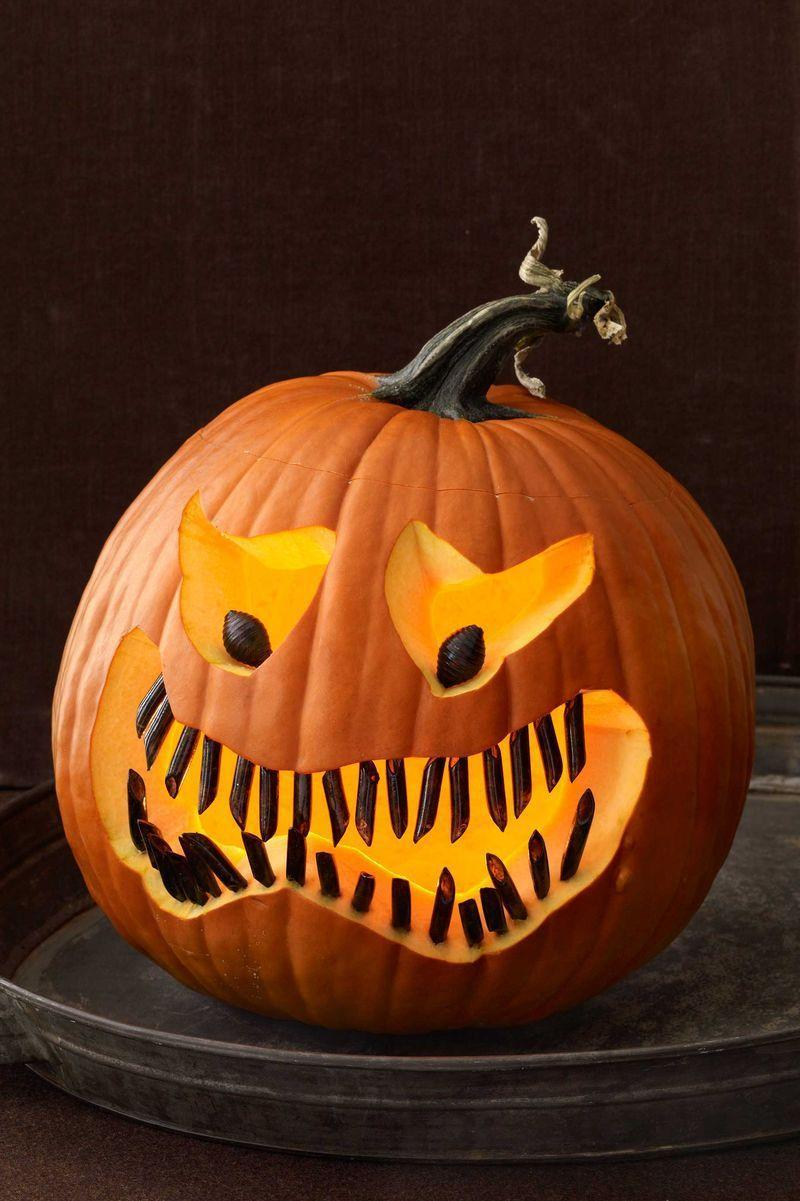 <p>Spray paint about 15 dry penne pieces and two shell pasta pieces black on a covered surface in a well-ventilated area. Let dry. Flip pasta over and repeat on the unpainted side. Carve freeform eyes and a jagged mouth onto your pumpkin, then push the black pasta pieces in to creates pupils and teeth.</p>