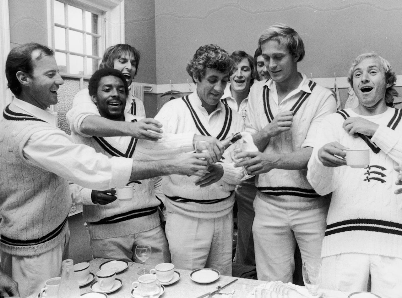 2nd September 1976:  Middlesex Cricketers celebrate in the dressing room after scoring sufficient points against Surrey at the Oval to assure them of the County Championship. Left to right : Mike Smith, RO Butcher, Mike Selvey, captain Mike Brearley, Phil Edmonds and Graham Barlow  (Photo by Dennis Oulds/Central Press/Getty Images)