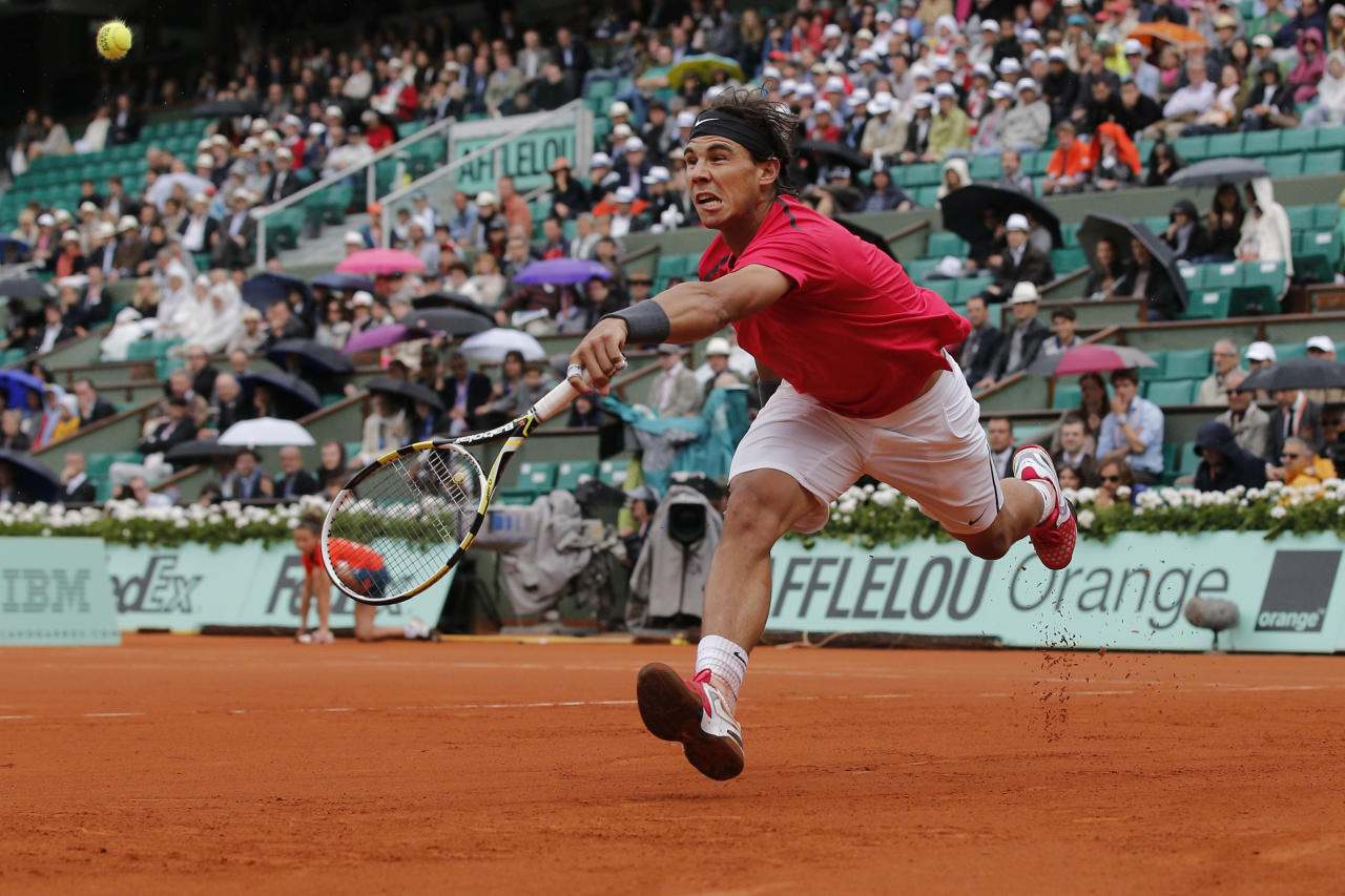 Rafael Nadal of Spain returns in his quarter final match against compatriot Nicolas Almagro at the French Open tennis tournament in Roland Garros stadium in Paris, Wednesday June 6, 2012. (AP Photo/Christophe Ena)