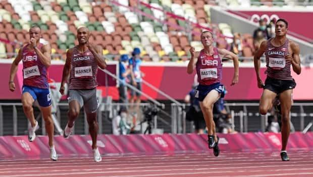 Zachery Ziemek, left, of the United States, Damian Warner of Canada, Steven Bastien of the U.S. and Pierce LePage of Canada compete in their decathlon 100-metre heat on Wednesday.  (Martin Meissner/The Associated Press - image credit)