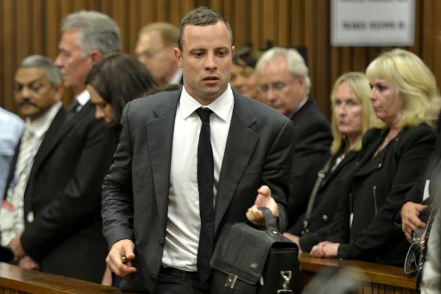"Olympic and Paralympic track star Oscar Pistorius arrives back in court after a lunch break during his trial at the North Gauteng High Court in Pretoria, March 3, 2014.The first witness at Pistorius' murder trial told the court on Monday she heard ""bloodcurdling screams"" from a woman followed by shots, a dramatic opening to a case that could see one of global sports' most admired role models jailed for life. Pistorius pleaded not guilty to murdering his girlfriend, model Reeva Steenkamp, on Valentine's Day last year. REUTERS/Herman Verwey/Pool (SOUTH AFRICA - Tags: SPORT ATHLETICS ENTERTAINMENT CRIME LAW)"