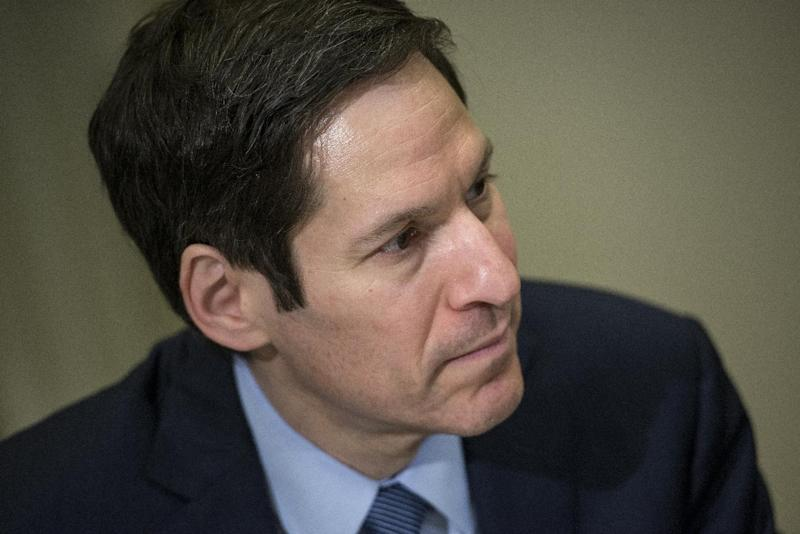 Dr. Tom Frieden, director of the Centers for Disease Control, listens while US President Barack Obama makes a statement to the press after a meeting in the Roosevelt Room of the White House October 6, 2014 in Washington, DC (AFP Photo/Brendan Smialowski)