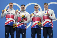 Britain's men's 4x200-meters relay team from left, Tom Dean, James Guy, Matthew Richards, and Duncan Scott pose with their gold medals at the 2020 Summer Olympics, Wednesday, July 28, 2021, in Tokyo, Japan. (AP Photo/Matthias Schrader)
