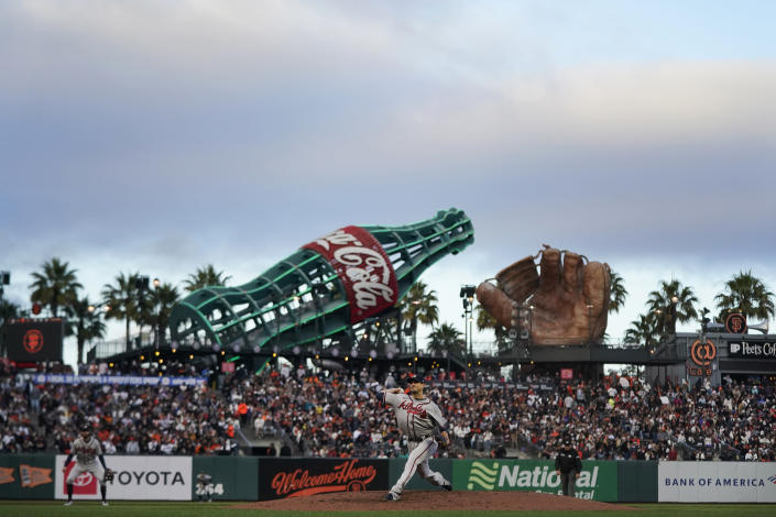 Atlanta Braves' Charlie Morton, bottom, pitches against the San Francisco Giants during the third inning of a baseball game in San Francisco, Saturday, Sept. 18, 2021. (AP Photo/Jeff Chiu)