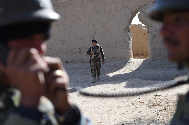 Afghan National Army soldiers patrol the compound of the mosque where Mullah Omar founded the Taliban movement over 20 years ago, in the village of Sangesar (AFP Photo/Roberto Schmidt)