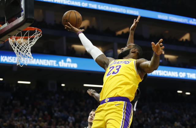 Los Angeles Lakers forward LeBron James goes to the basket against the Sacramento Kings during the first quarter of an NBA basketball game in Sacramento, Calif., Saturday, Feb. 1, 2020. (AP Photo/Rich Pedroncelli)