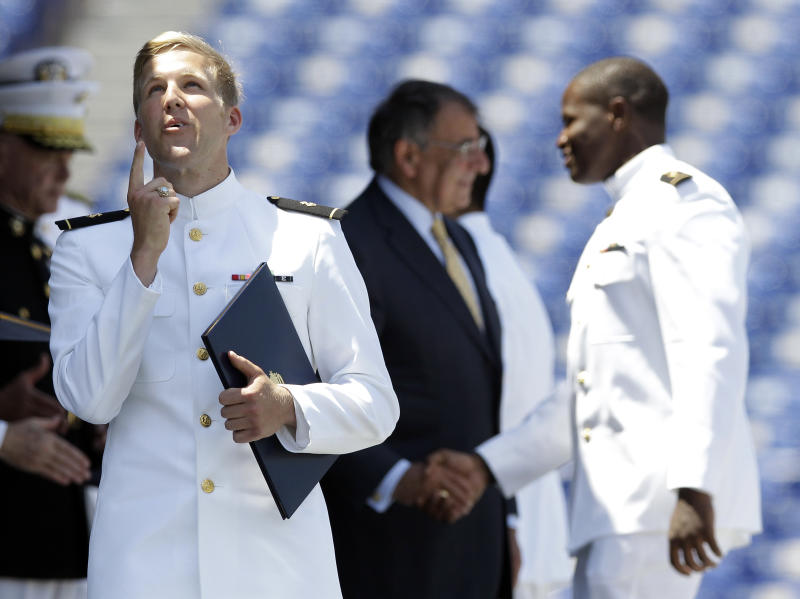 A United States Naval Academy Midshipman reacts after receiving his diploma as Secretary of Defense Leon Panetta, background center, shakes hands with a Midshipman during the Academy's graduation and commissioning ceremonies in Annapolis, Md., Tuesday, May 29, 2012. The Pentagon chief said Tuesday building U.S. maritime strength across the Asia-Pacific region will be one of the main projects for the new generation of America's naval officers. (AP Photo/Patrick Semansky)