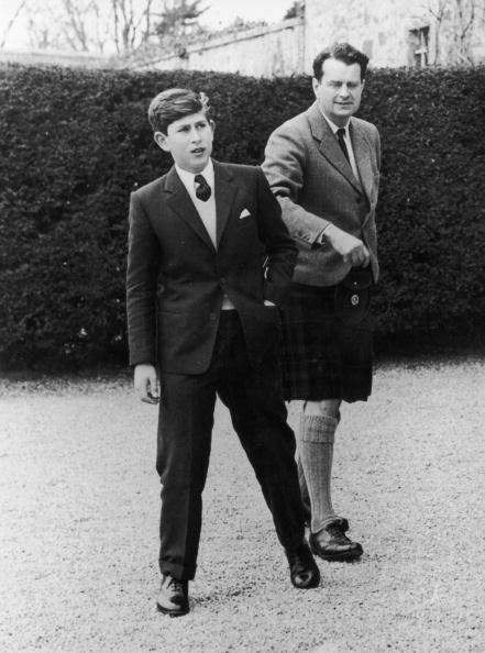 <p>Prince Charles arrives at Gordonstoun School in Scotland for his first term. Here, he's with Captain Iain Tennant, chairman of the board of governors.</p>