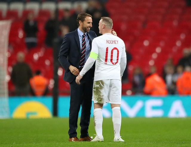 England manager Gareth Southgate shakes hands with Rooney