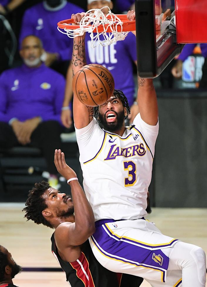 The Lakers' Anthony Davis dunks over the Heat's Jimmy Butler during Game 6 of the NBA Finals.
