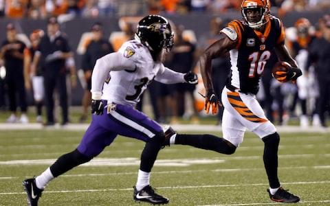 Cincinnati Bengals wide receiver A.J. Green (18) runs against Baltimore Ravens defensive back Eric Weddle (32) for a touchdown during the first half at Paul Brown Stadium - Credit: David Kohl/USA Today