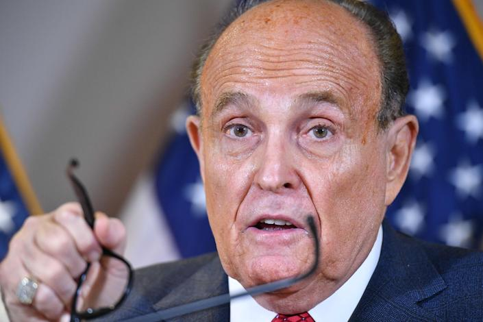 <p>Rudy Giuliani speaks during a press conference at the Republican National Committee headquarters in Washington, DC, on 19 November 2020</p> ((AFP via Getty Images))