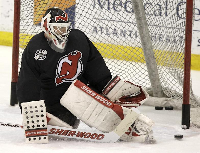 New Jersey Devils goalie Martin Brodeur makes a save during practice in preparation for Game 1 of the NHL hockey Stanley Cup Final series against the Los Angeles Kings, Tuesday, May 29, 2012, in Newark, N.J. (AP Photo/Julio Cortez)