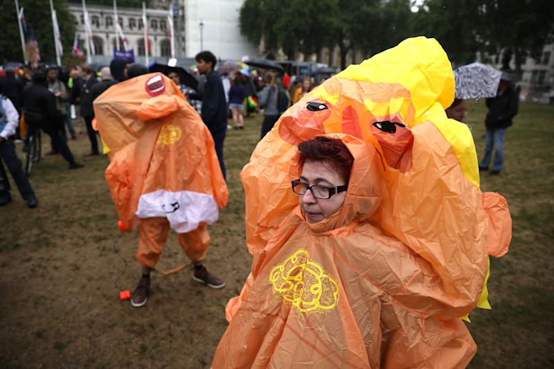 Protesters dressed in inflatable Donald Trump baby costumes stand in the rain at Parliament Square.(Photo: Dan Kitwood/Getty Images)