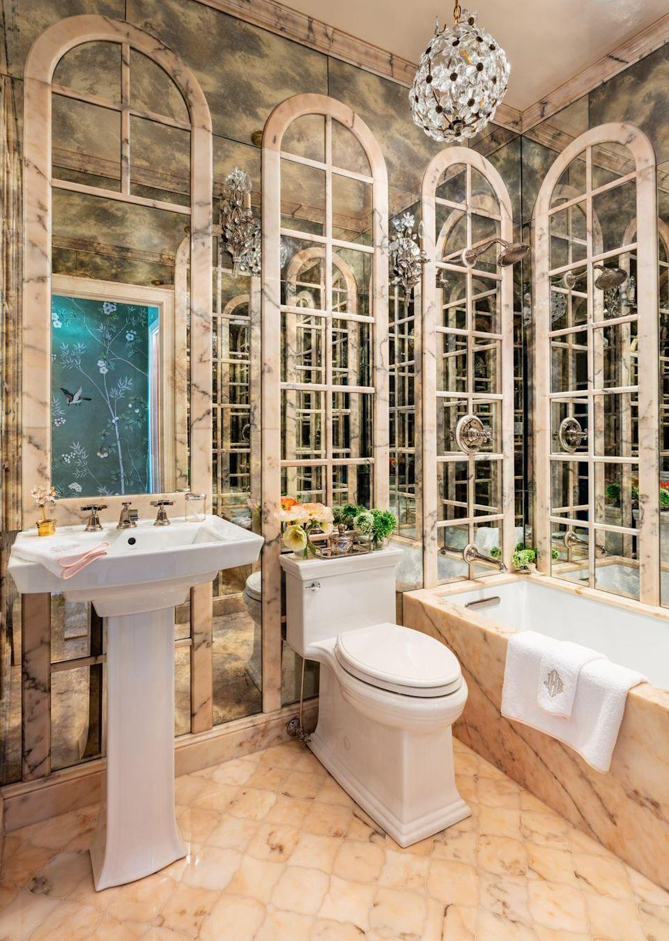<p>Watch out, Versailles: There's a new hall of mirrors in town. Bromley's brilliant, kaleidoscopic guest bath comes courtesy of antiqued mirror panes covering every wall, <strong>a dramatic effect that also makes the space appear much larger. </strong>The floors, tub, and trim, in Rosa Portugal marble, make the case for bringing back the monochrome pink bathrooms of the 70s and 80s. </p>