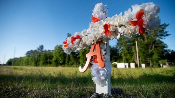 PHOTO: A cross with flowers and the letter A sits at the entrance to the Satilla Shores neighborhood where Ahmaud Arbery was shot and killed, May 7, 2020 in Brunswick, Ga. (Sean Rayford/Getty Images)
