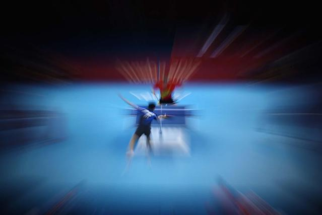 LONDON, ENGLAND - AUGUST 02: Hao Wang of China completes during his Men's Singles Table Tennis semifinal match against Chih-Yuan Chuang of Chinese Taipei on Day 6 of the London 2012 Olympic Games at ExCeL on August 2, 2012 in London, England. (Photo by Feng Li/Getty Images)