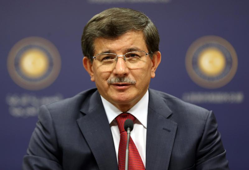 Turkey's Foreign Minister Ahmet Davutoglu speaks during a news conference in Ankara on July 3, 2014