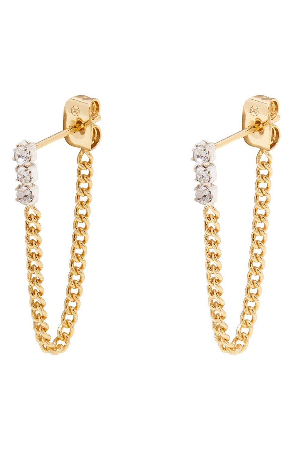 """<p><strong>Gorjana</strong></p><p>nordstrom.com</p><p><strong>$45.00</strong></p><p><a href=""""https://go.redirectingat.com?id=74968X1596630&url=https%3A%2F%2Fwww.nordstrom.com%2Fs%2Fgorjana-wilder-shimmer-chain-huggie-hoop-earrings%2F5781013&sref=https%3A%2F%2Fwww.oprahmag.com%2Fstyle%2Fg32948480%2Fbest-earrings-for-sensitive-ears%2F"""" rel=""""nofollow noopener"""" target=""""_blank"""" data-ylk=""""slk:SHOP NOW"""" class=""""link rapid-noclick-resp"""">SHOP NOW</a></p><p>Delicate chains and cubic zirconias prove to be a pretty combo. Because the base metal of this pair is sterling silver, you likely won't have to worry about any irritations if the top 18k gold-plated layer rubs off with time. </p>"""