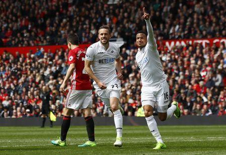 Britain Football Soccer - Manchester United v Swansea City - Premier League - Old Trafford - 30/4/17 Swansea City's Gylfi Sigurdsson celebrates with Martin Olsson after scoring their first goal Action Images via Reuters / Jason Cairnduff Livepic