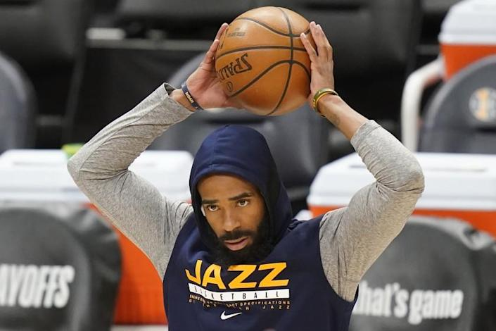 Utah Jazz guard Mike Conley stands on the court before Game 1 of the team's second-round NBA basketball playoff series against the Los Angeles Clippers on Tuesday, June 8, 2021, in Salt Lake City. Conley suffered a mild right hamstring strain in Game 5 against the Grizzlies, and he has been ruled out of Tuesday night's game. (AP Photo/Rick Bowmer)