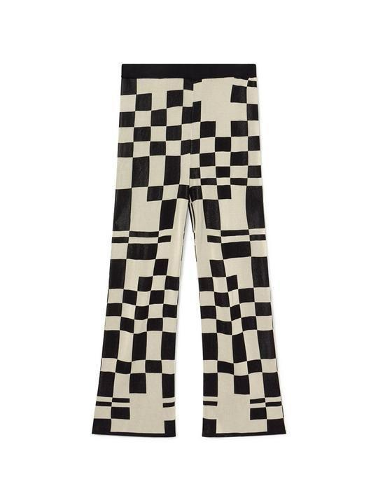 """<p><strong>Paloma Wool</strong></p><p>palomawool.com</p><p><strong>14500.00</strong></p><p><a href=""""https://palomawool.com/products/puerto-elastic-high-waist-knitted-pants-black"""" rel=""""nofollow noopener"""" target=""""_blank"""" data-ylk=""""slk:SHOP IT"""" class=""""link rapid-noclick-resp"""">SHOP IT</a></p><p>Turn heads in these eye-catching graphic pants. </p>"""