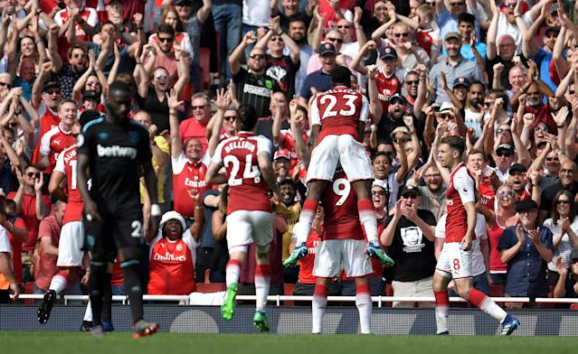 """Soccer Football - Premier League - Arsenal v West Ham United - Emirates Stadium, London, Britain - April 22, 2018 Arsenal's Alexandre Lacazette celebrates with team mates in front of their fans after scoring their third goal REUTERS/Toby Melville EDITORIAL USE ONLY. No use with unauthorized audio, video, data, fixture lists, club/league logos or """"live"""" services. Online in-match use limited to 75 images, no video emulation. No use in betting, games or single club/league/player publications. Please contact your account representative for further details."""