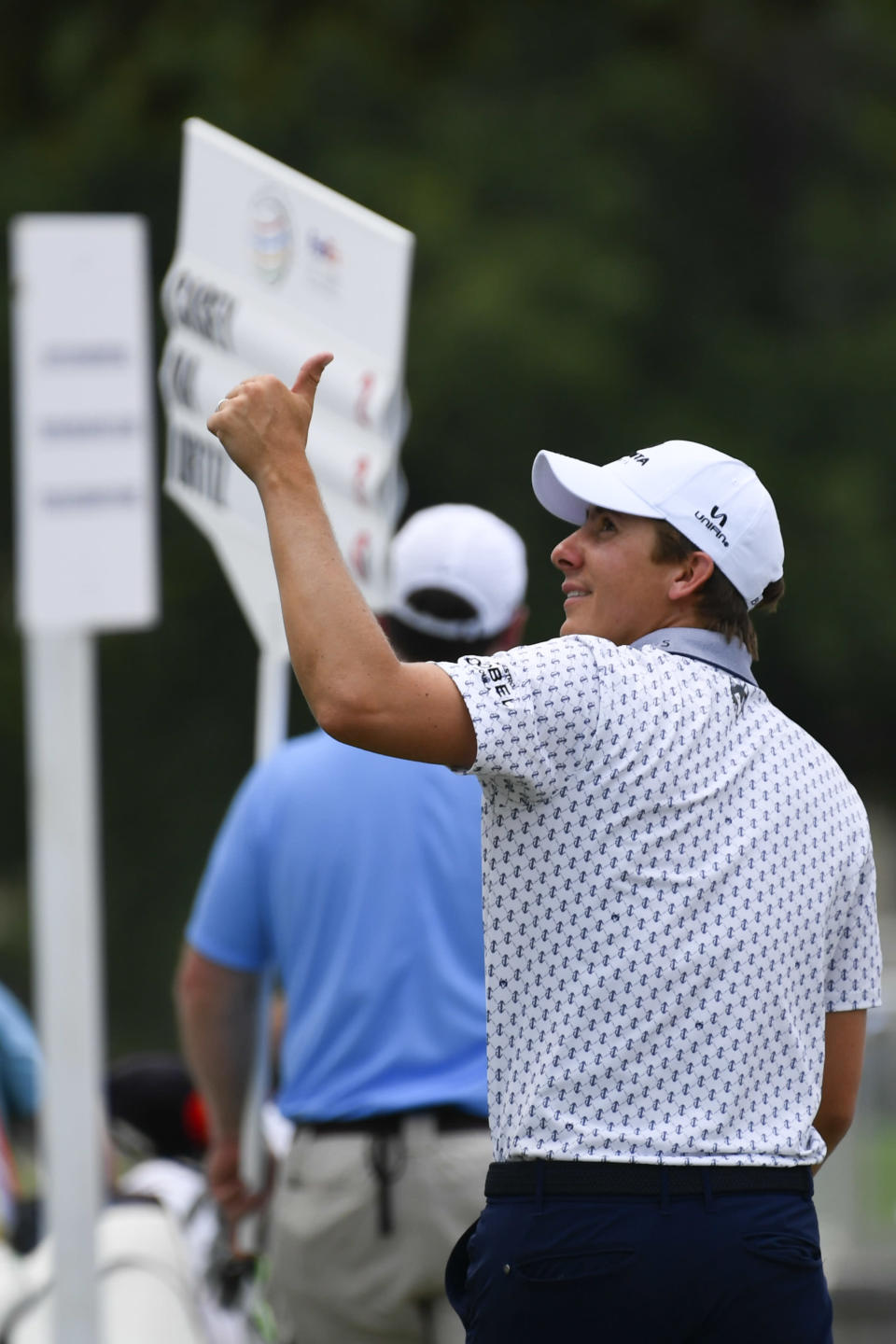 Carlos Ortiz, of Mexico, gestures to spectators as he walks off the 18th green after finishing the first round of the World Golf Championship-FedEx St. Jude Invitational tournament, Thursday, Aug. 5, 2021, in Memphis, Tenn. (AP Photo/John Amis)