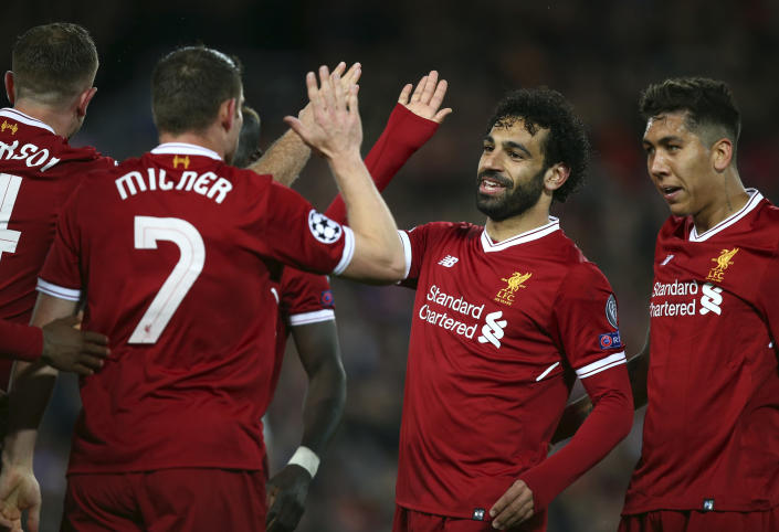 """<a class=""""link rapid-noclick-resp"""" href=""""/soccer/teams/liverpool/"""" data-ylk=""""slk:Liverpool"""">Liverpool</a>'s <a class=""""link rapid-noclick-resp"""" href=""""/soccer/players/mohamed-salah/"""" data-ylk=""""slk:Mohamed Salah"""">Mohamed Salah</a>, second from right, celebrates with teammates after their third goal against <a class=""""link rapid-noclick-resp"""" href=""""/soccer/teams/roma/"""" data-ylk=""""slk:Roma"""">Roma</a> in the Champions League semifinals first leg on Tuesday at Anfield. (Associated Press)"""
