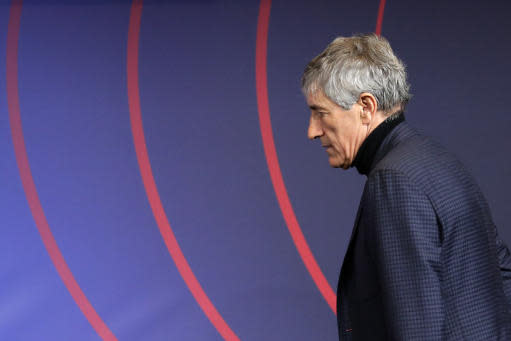 Quique Setien arrives on the stage to be officially introduced as the new soccer coach of FC Barcelona at the Camp Nou stadium in Barcelona, Spain, Tuesday, Jan. 14, 2020. Barcelona made a rare coaching change midway through the season, replacing Ernesto Valverde with former Real Betis manager Quique Setien on Monday. (AP Photo/Emilio Morenatti)