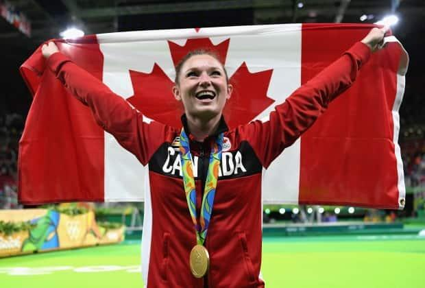 MacLennan celebrates her gold medal in trampoline at the 2016 Rio Olympics.